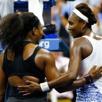 Venus and Serena Williams embrace after Serena defeats her sister to advance to the semi-finals. (Al Bello/Getty Images)