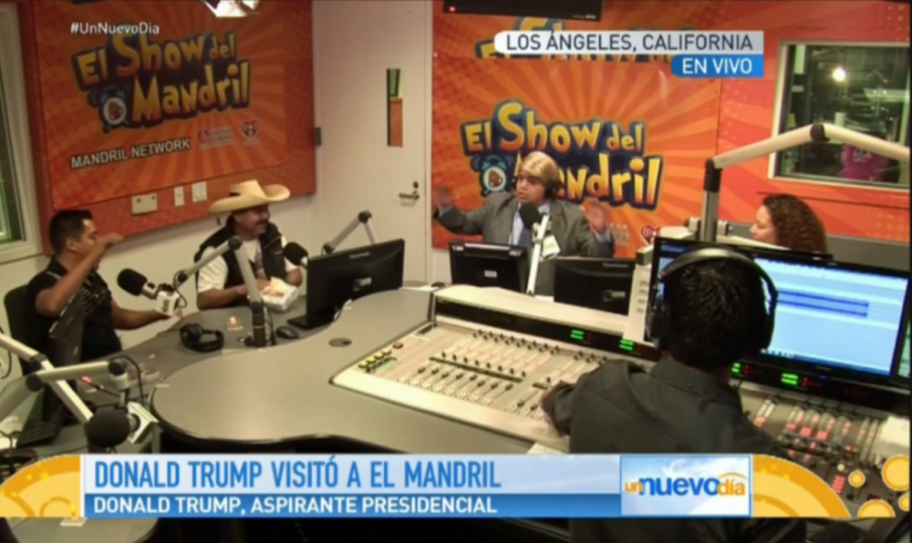 "In this screenshot from a broadcast of ""Un Nuevo Dia"" on Telemundo, a man impersonates Donald Trump for a skit. (telemundo.com)"
