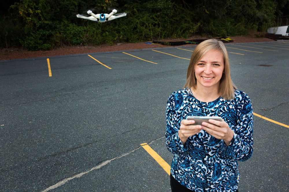 CyPhy Works CEO Helen Greiner stands with the company's new consumer LVL 1 drone, which is controlled by swiping your smartphone's screen. (Jesse Costa/WBUR)