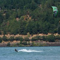 No waves needed. Surfers use kites to glide across the river. (Jason Albert/Only A Game)