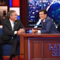 "Stephen Colbert, right, talks with Republican presidential candidate Jeb Bush during the premiere episode of ""The Late Show,"" Tuesday Sept. 8, 2015, in New York. Bush and actor George Clooney were the guests for Colbert's debut. (AP)"