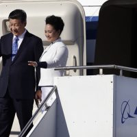 Chinese President Xi Jinping, left, and his wife Peng Liyuan wave on their arrival Tuesday, Sept. 22, 2015, at Boeing Field in Everett, Wash. (AP)