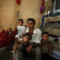In this Thursday, Sept. 10, 2015 photo, Syrian refugee Ibrahim Mahmoud speaks during an interview with The Associated Press surrounded by his children inside his tent at a Syrian refugee camp in the town of Deir Zanoun, Bekaa Valley, Lebanon. (AP)