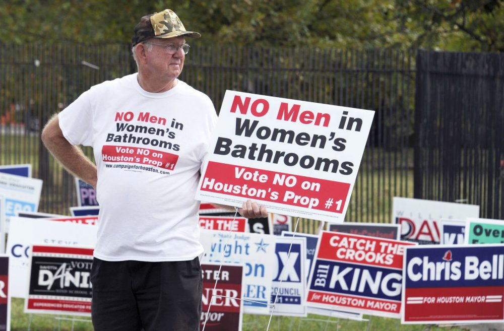 In this Oct. 21, 2015 photo, a man urges people to vote against the Houston Equal Rights Ordinance outside an early voting center in Houston. On Tuesday, Nov. 3, 2015, voters statewide can give themselves tax breaks, pump billions of dollars into roads and make hunting and fishing constitutional rights by supporting seven amendments to the Texas Constitution on Tuesday's ballot. And Houston will choose a new mayor and decide whether to extend nondiscrimination protections to its gay and transgender residents in a referendum being watched nationally. (Pat Sullivan/AP)