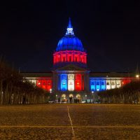 San Francisco's City Hall is illuminated in blue, white and red in San Francisco, California on November 14, 2015, one day after the Paris terrorist attacks. Stirring renditions of 'La Marseillaise' rang out from Dublin to New York as global landmarks were bathed in the French colors and thousands marched in solidarity with Paris after attacks that left at least 129 dead. (Josh Edelson/AFP/Getty Images)