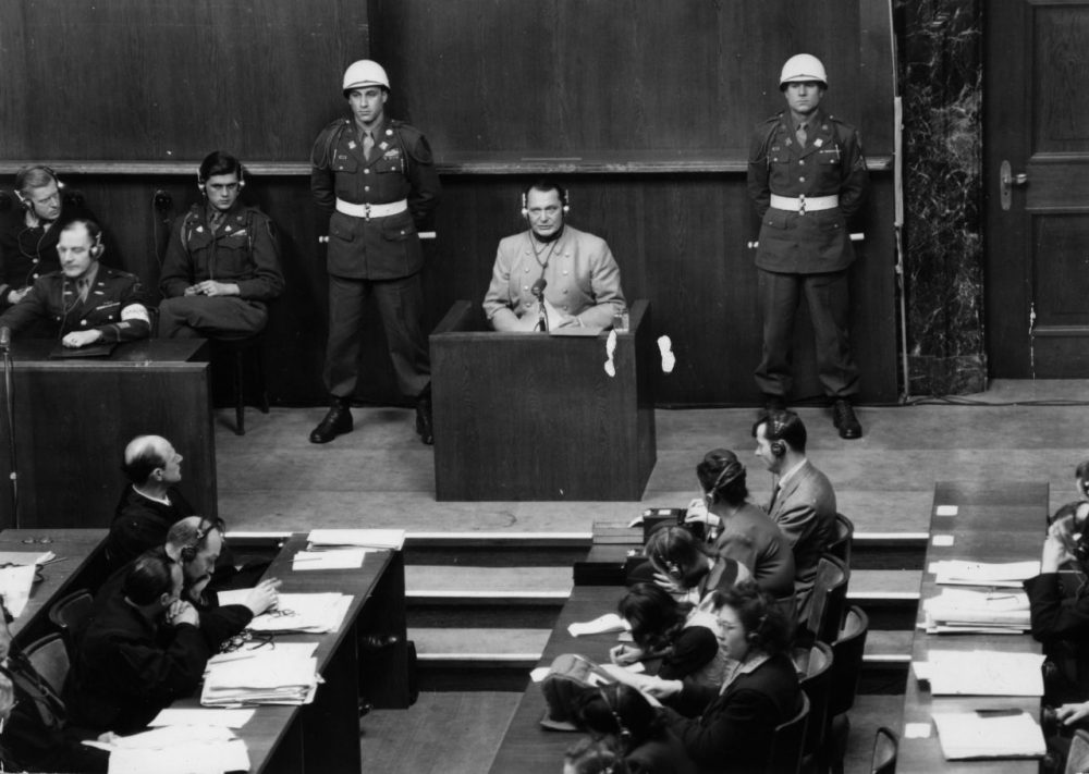 Nazi leader Hermann Goering (1893 - 1946) is pictured on March 16, 1946, in the witness box at the Nuremberg War Crime Trials, where he was later sentenced to death. (Keystone/Getty Images)
