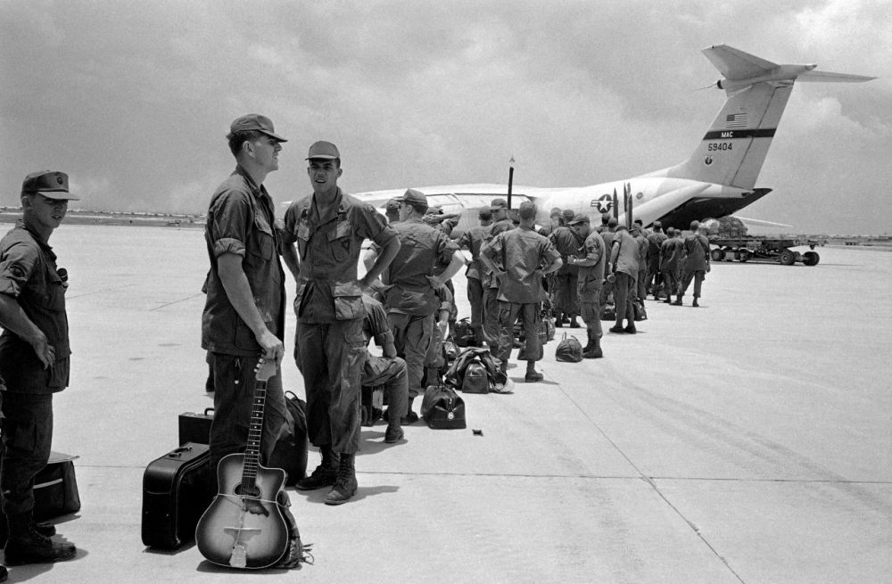 Some of the 300 troops of the 9th Infantry Division scheduled for departure from South Vietnam line up to board aircraft bound for Hawaii, August 27, 1969. (AP)