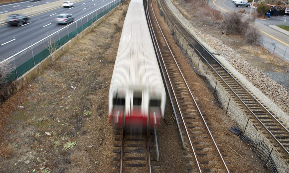 An MBTA Red Line train barrels down the tracks on its way to Braintree Station on Thursday morning, after another train left the station without an operator. The T is investigating. (Jesse Costa/WBUR)