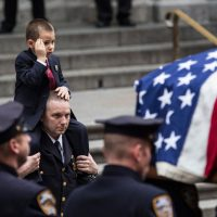 Ryan Lemm, age four, the son of New York Police Department (NYPD) Detective and Air National Guard Sergeant Joseph Lemm, salutes while his father's casket is brought out of St. Patrick's Cathedral after his father's funeral on December 30, 2015 in New York City. Lemm was killed on his third tour of duty in Afghanistan on December 21. (Andrew Burton/Getty Images)