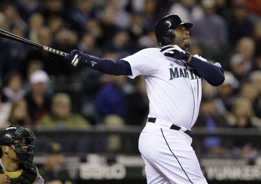 b2d5a14e44 Seattle Mariners' Ken Griffey Jr. watches his three-run home run along with
