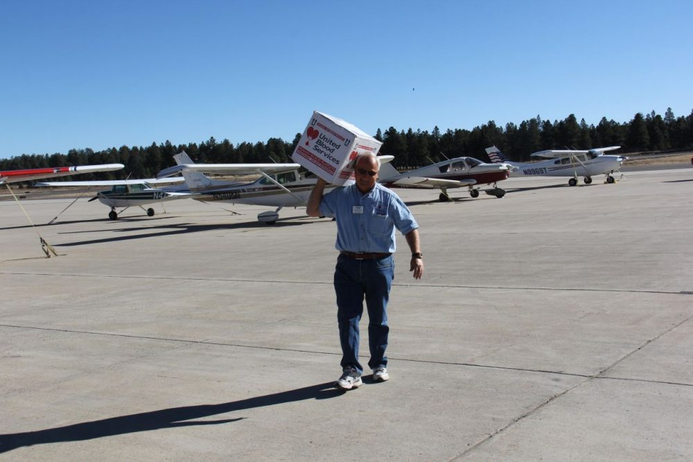 Paul Rowley delivers a box of platelets to the Flagstaff Pulliam airport to then be picked up by a local hospital. (Chloe Nordquist/KJZZ News)