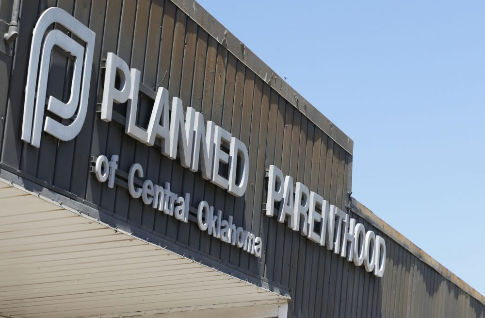 A sign at a Planned Parenthood Clinic is pictured in Oklahoma City, July 24, 2015. The furor on Capitol Hill over Planned Parenthood has stoked a debate about the use of tissue from aborted fetuses in medical research, but U.S. scientists have been using such cells for decades to develop vaccines and seek treatments for a host of ailments, from vision loss and neurological disorders to cancer and AIDS. (Sue Ogrocki/AP)