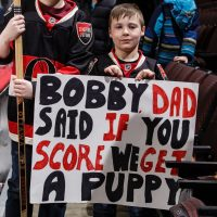 Two young Ottowa Senators fans scored a puppy when Bobby Ryan netted home a goal against the New York Rangers.  (Photo by Jana Chytilova/Freestyle Photography/Getty Images)