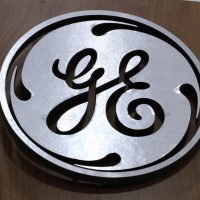 FILE - This Jan. 16, 2014 file photo shows the General Electric logo at a store in Cranberry Township, Pa. General Electric announced Wednesday, Jan. 13, 2016, it will move its headquarters from Fairfield, Conn., to the Seaport District of Boston. (AP Photo/Gene J. Puskar, File)