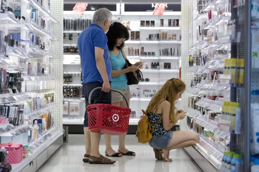 In this Aug. 21, 2015, file photo, people shop the cosmetics section of the CityTarget store in Boston. (Michael Dwyer/AP)
