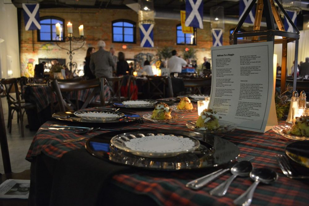 A table ready and set for a night of food and drink in celebration of Robert Burns. (Sam Whitehead/GPB News)
