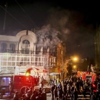 Smoke rises as Iranian protesters set fire to the Saudi embassy in Tehran, Sunday, Jan. 3, 2016. Protesters upset over the execution of a Shiite cleric in Saudi Arabia set fires to the Saudi embassy in Tehran. (Mohammadreza Nadimi/ISNA via AP)