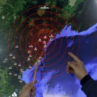 Officers from the Korea Meteorological Administration point at the epicenter of seismic waves in North Korea, at the National Earthquake and Volcano Center of the Korea Meteorological Administration in Seoul, South Korea, Wednesday, Jan. 6, 2016. North Korea said it conducted a powerful hydrogen bomb test Wednesday, a defiant and surprising move that, if confirmed, would be a huge jump in Pyongyang's quest to improve its still-limited nuclear arsenal. (AP Photo/Lee Jin-man)