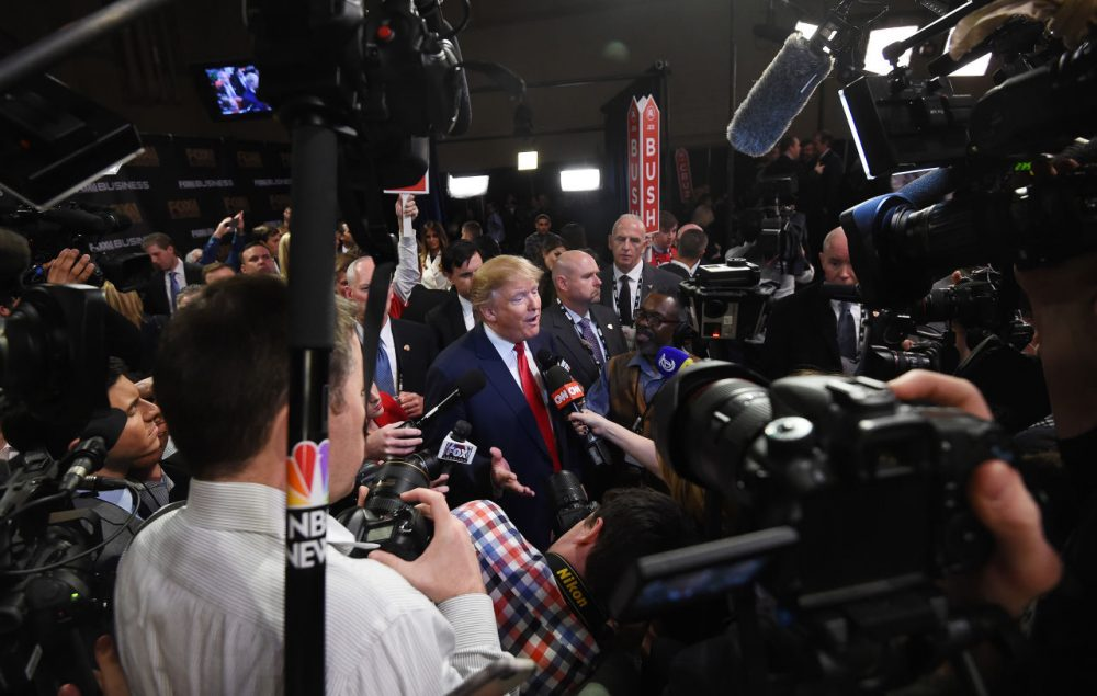 Republican presidential candidate, businessman Donald Trump speaks in the spin room after the Fox Business Network Republican presidential debate at the North Charleston Coliseum, Thursday, Jan. 14, 2016, in North Charleston, S.C. (AP Photo/Rainier Ehrhardt)