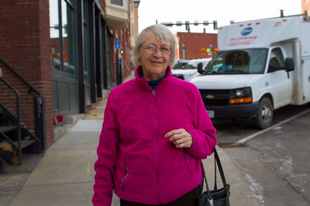 "Louise Graham, a retired school teacher who has lived in New Hampshire for 40 years, said her number one issue in this election is ""working towards a more fair distribution of wealth."" (Hadley Green for WBUR)"