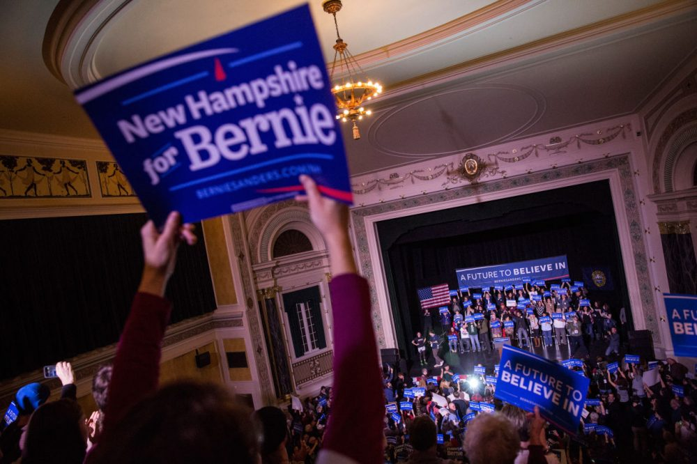 Audience members cheer for Democratic Presidential candidate Sen. Bernie Sanders at a rally in Keene, New Hampshire on Feb. 2, 2016. (Andrew Burton/Getty Images)