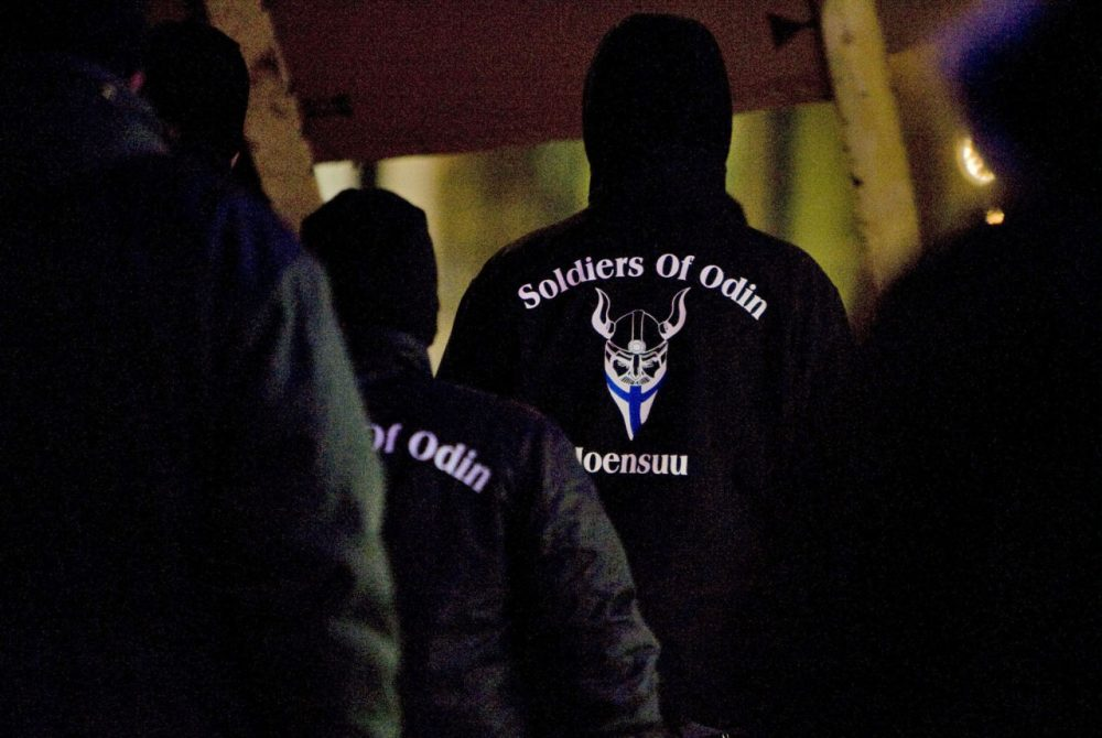 In this photo taken on Friday, Jan. 8, 2016, a group that calls itself the Soldiers of Odin demonstrates in Joensuu, Finland. The rise of the Soldiers of Odin, which claims 500 members, has sparked both concern and ridicule in the Nordic country. They derive their name from a Norse god, and insist their patrols are needed to protect the peace in the sparsely populated nation of 5.5 million, which wasn''t a major destination for migrants until 32,500 people applied for asylum last year. The Soldiers are now being challenged by a group of smiling women offering hugs and even some clowns. (Minna Raitavuo/Lehtikuva via AP)