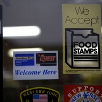 A supermarket displays stickers indicating they accept food stamps in West New York, New Jersey. (Seth Wenig/AP)