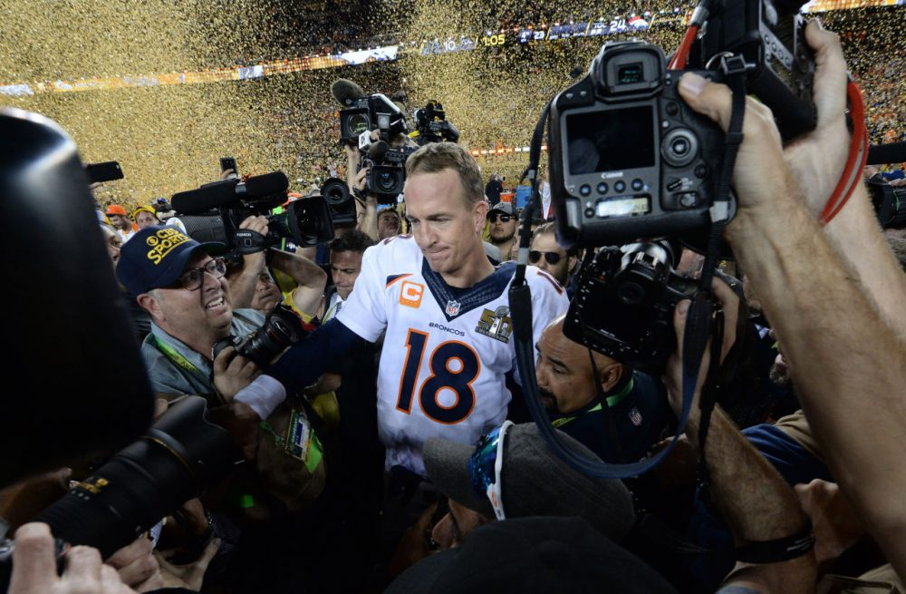 Quarterback Petyton Manning of the Denver Broncos is surrounded by the media following victory over the Carolina Panthers in Super Bowl 50 at Levi's Stadium in Santa Clara, California February 7, 2016. Peyton Manning clinched a fairytale second Super Bowl victory as the Denver Broncos produced an astonishing defensive display to defeat the Carolina Panthers 24-10. (Timothy A. Clary/AFP/Getty Images)