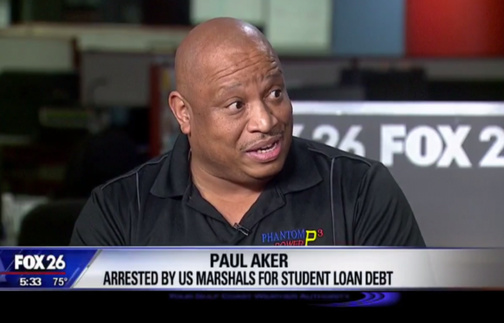 In this screen grab from Houston Fox 26, Paul Aker describes how he was arrested by U.S. Marshals for his student loan debt. (Screenshot)