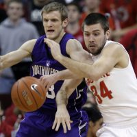 Ohio State's Mark Titus, right, and Northwestern's Mike Capocci fight for a loose ball during the second half of an NCAA college basketball game Tuesday, Jan. 19, 2010, in Columbus, Ohio. Ohio State beat Northwestern 76-56. (AP Photo/Jay LaPrete)