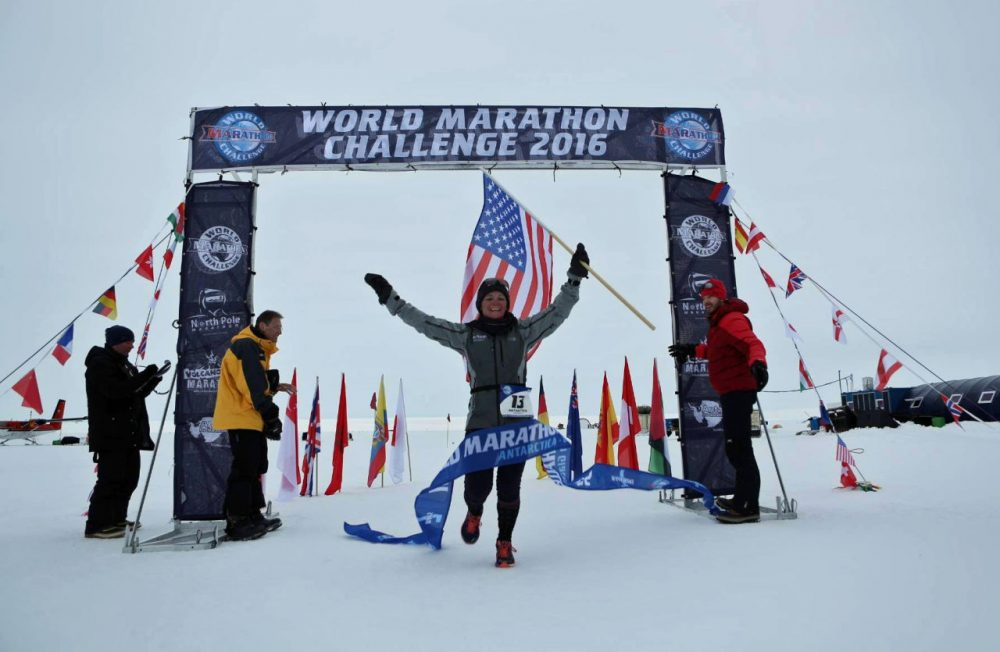 Becca Pizzi crosses the finish line in Antarctica for the World Marathon Challenge 2016. (Courtesy)