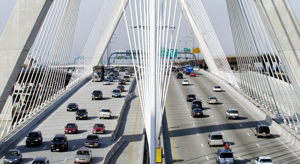 "Thomas J. Fitzgerald: ""Massachusetts had a net loss in domestic migration of 21,805 residents from July 2014 to July 2015, roughly the equivalent of losing the town of Winchester."" Pictured: A stretch of Interstate 93 over the Leonard P. Zakim Bunker Hill Bridge in Boston. (Michael Dwyer/AP)"