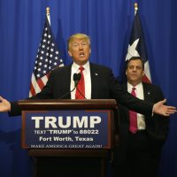 Republican presidential candidate Donald Trump, accompanied by New Jersey Gov. Chris Christie, speaks before a rally in Fort Worth, Texas, Friday, Feb. 26, 2016. (AP Photo/LM Otero)