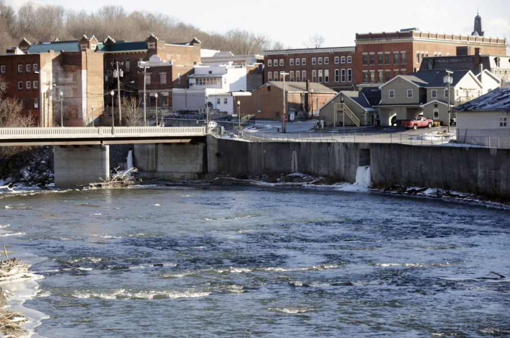 In this Jan. 21, 2016, photo, the Hoosic River runs through the village of Hoosick Falls, N.Y. New York regulators say Saint-Gobain Performance Plastics and Honeywell International are required to pay for the investigation and cleanup of a toxic chemical in the upstate village's drinking water. (Mike Groll/AP)