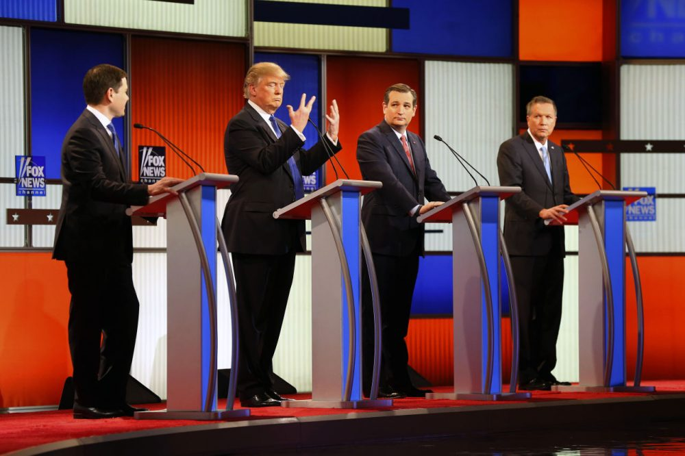 "Republican presidential candidate, businessman Donald Trump, second from left, talks about his hand size at the Republican presidential primary debate at Fox Theatre, Thursday, March 3, 2016, in Detroit. ""And [Marco Rubio] referred to my hands – 'if they're small, something else must be small.' I guarantee you there's no problem. I guarantee,"" Trump said. (Paul Sancya/AP)"