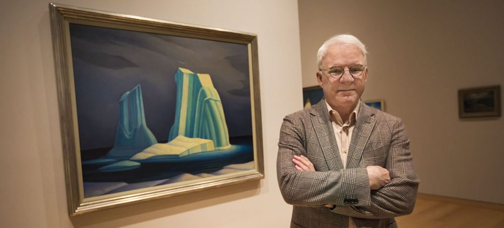 "Steve Martin is curating a new show about Canadian modernist painter Lawren Harris. Here, Martin stands in front of Harris' ""Icebergs,"" on display at the Museum of Fine Arts in Boston. (Jesse Costa/WBUR)"