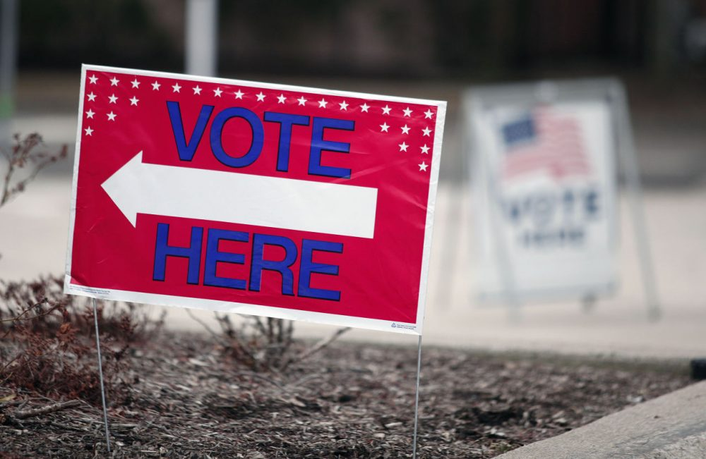 A sign directs residents to vote in the Michigan primary March 8, 2016 in Royal Oak, Michigan. There are 59 Republican delegates and 130 Democratic delegates up for grabs in Michigan. Mississippi and Idaho are also holding primaries and Hawaii is holding a caucus. (Bill Pugliano/Getty Images)