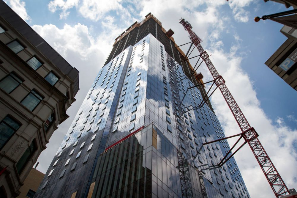 The Millennium Tower is seen undergoing construction in Boston in July 2015. (Hadley Green for WBUR)