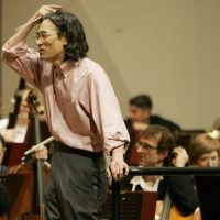 Conductor Kent Nagano, music director of Montreal Symphony Orchestra, talks to the orchestra members during a rehearsal of their Japan tour prior to the opening concert at Musashino Civic Cultural Hall in Tokyo Thursday, April 10, 2008. The Canadian orchestra is in Japan for a six-concert tour until April 16. (AP Photo/Koji Sasahara)