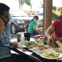 Nas Juma, 22, left, and Omar Ghanim, 23, enjoy Lebanese pizza at Forn Al Hara restaurant in Orange County's Little Arabia in Anaheim, Calif., Tuesday, March 22, 2016. Earlier that day, Republican presidential candidate Ted Cruz said that surveillance in Muslim neighborhoods in the U.S. must be intensified following the deadly bombings at Brussels. (Gillian Flaccus/AP)