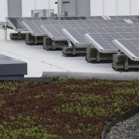 "Solar panels and a green roof are among the sustainably-built features of the new Google building on the company's campus Tuesday, Feb. 16, 2016, in Kirkland, Wash. The new building is on a site that formerly housed a chemical mixing and packaging plant. After completing an environmental cleanup in 2012, the property manager conducted a second cleanup to voluntarily surpass state standards and remove all detectable remaining contamination at the property. Google said that the Washington Department of Ecology has called the cleanup ""cleaner than clean"" and plans to remove the area from the state's contaminated sites list. (AP Photo/Elaine Thompson)"