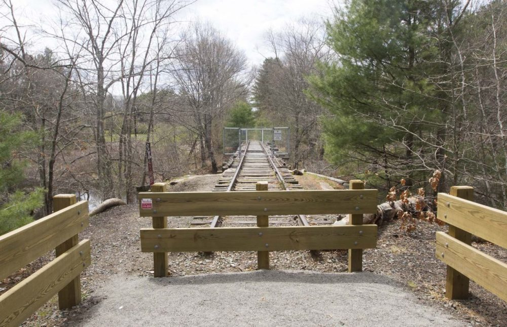 By a vote of 475 to 334, residents at Monday's town meeting approved giving the Board of Selectmen the authority to lease the land from the MBTA for 99 years for a controversial bike trail. (Joe Difazio for WBUR)
