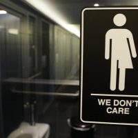 In this photo taken Thursday, May 12, 2016, signage is seen outside a restroom at 21c Museum Hotel in Durham, N.C. North Carolina is in a legal battle over a state law that requires transgender people to use the public restroom matching the sex on their birth certificate. The ADA-compliant bathroom signs were designed by artist Peregrine Honig. (Gerry Broome/AP)