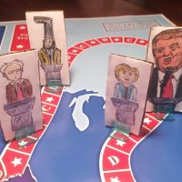 "In this handout photo taken April 20, 2016, and provided by Steve Polczwartek New Hampshire presidential primary candidates are seen on a new board game called  ""Trunks 'N Asses"" developed by Steve Polczwartek and Blake Amacker, co-workers in Keene, N.H. The game features six candidates _ Republicans Donald Trump, Ted Cruz and Marco Rubio; Democrats Hillary Clinton and Bernie Sanders; and Vermin Supreme, a performance artist and perennial candidate in the New Hampshire primary.  (Steve Polczwartek via AP)"