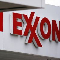 This April 29, 2014, file photo, shows an Exxon sign at a Exxon gas station in Carnegie, Pa. (AP Photo/Gene J. Puskar, File)