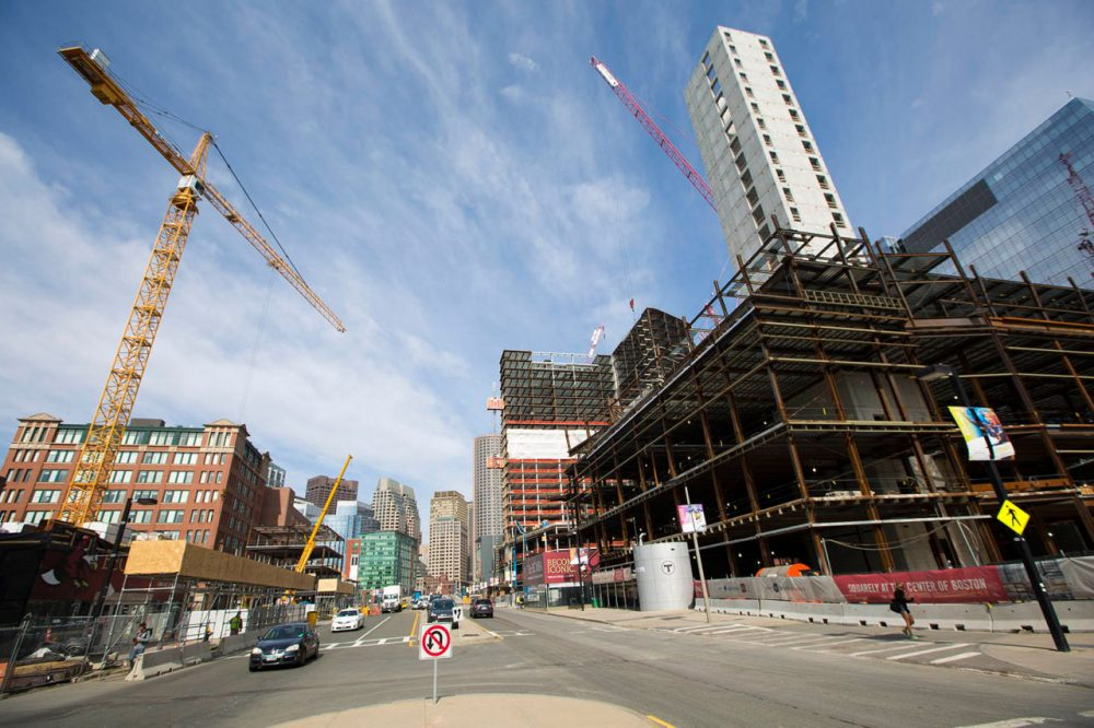 The gap between the rich and the poor is a theme that increasingly defines the city of Boston, with its booming innovation economy -- and its growing number of people struggling at the bottom of the economic ladder. Here's construction in the heart of South Boston's Innovation District in March. (Jesse Costa/WBUR)