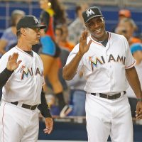 MIAMI, FL - MAY 11:  Manager Don Mattingly, left,  #8 of the Miami Marlins speaks with batting coach Barry Bonds as they wait to congratulate players after they defeated the Miami Marlins 3-2 at Marlins Park on May 11, 2016 in Miami, Florida.   (Photo by Joe Skipper/Getty Images)