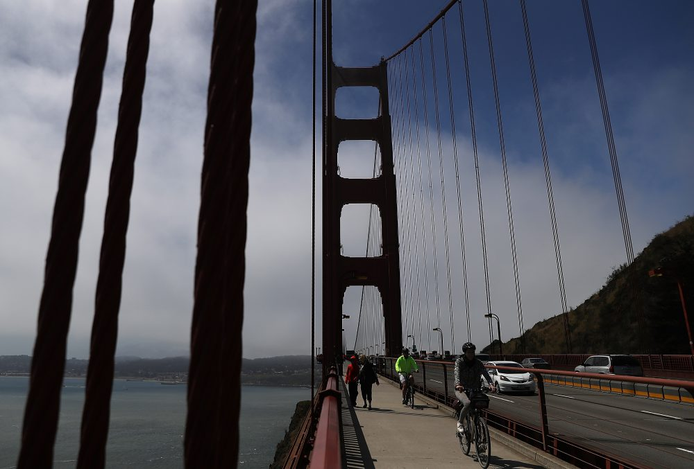 Cyclists ride by the north tower of the Golden Gate Bridge on June 28, 2016 in San Francisco, California. (Justin Sullivan/Getty Images)