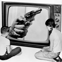 "Steve Almond: Pictured: A composite of two children looking at a hand holding a gun on a TV screen, in New York, June 21, 1968. The original caption asked: ""Will we ever see the day when the fist clenched around the grip of a deadly weapon will cease being shown as 'part of the times' we live in?"" Almost 48 years to the day later, America has yet to solve its problem of gun violence. (Bob Wands/AP)"