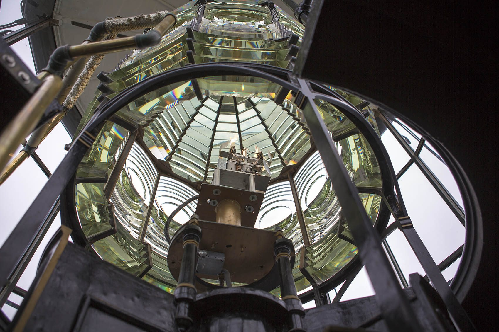 Looking from below at Boston Light's lamp and second-order Fresnel lens. (Jesse Costa/WBUR)